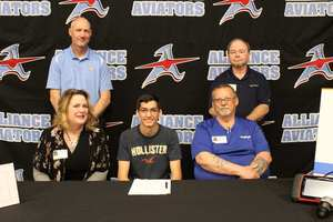 Two students sign for career commitments after High School