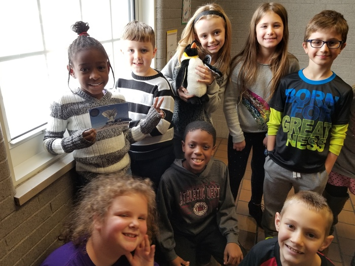 In back, from left to right: Mar'Rihanna Stewart (holding the postcard), Liam Monk, Kendyl Brown (holding Pauline), Stella Jackson, Aidan Kern In front, from left to right: Piper Kirkpatrick, Mathias Hill, Caleb Lega.