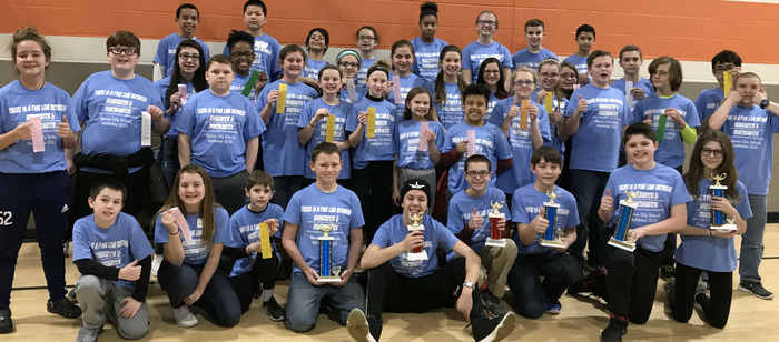 Math Tournament participants pose with trophies/ribbons