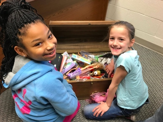 MyKayla & Cara enjoy searching for a prize in the treasure chest! Keep up the good behavior girls!